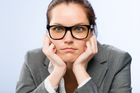 tedious: Tedious job woman bored at work in glasses Stock Photo