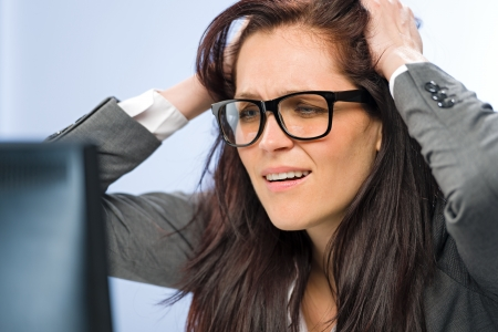 crazy hair: Stressed businesswoman overcharged with work in glasses Stock Photo