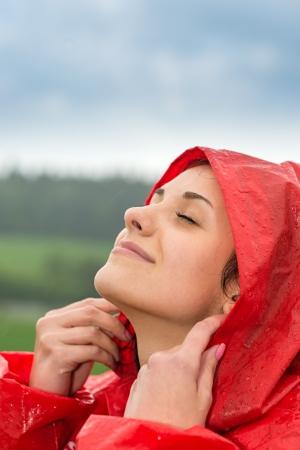 Portrait of young girl feeling the fresh rain outside photo