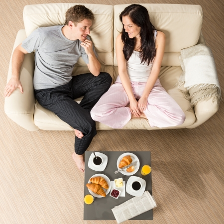 Joyful couple sitting in the morning before breakfast Stock Photo - 20142141