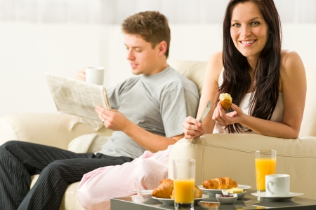 Young couple spending morning time together eating and reading Stock Photo - 20142176