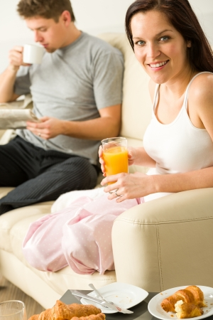 Resting couple having breakfast together in hotel room Stock Photo - 20142178