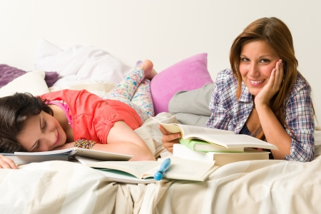dorm: Young caucasian girls studying at home Stock Photo