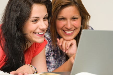 Joyful caucasian teens browsing on internet Stock Photo - 20244517