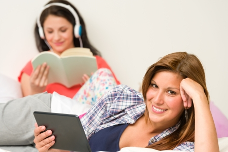 Best friends resting and reading in their room Stock Photo - 20244488