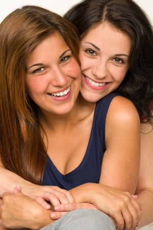 Portrait of embracing happy best friend Stock Photo - 20244532