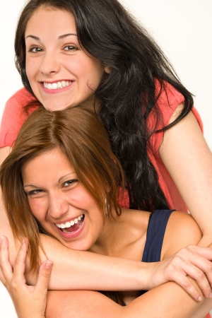 Portrait of pretty teens laughing and smiling at camera photo