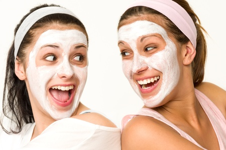 Cheerful girls having facial mask and laughing at each other Stock Photo - 20244523