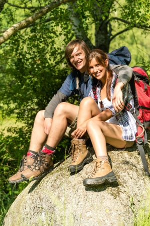 Portrait of hikers young couple outdoors sunny day photo