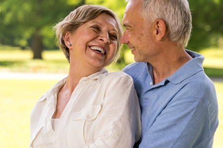 Happy retirement senior couple hugging and smiling at each other Stock Photo - 21302814