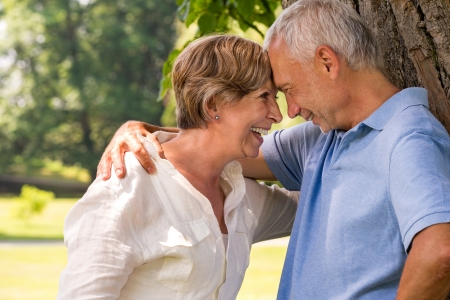 Elderly Caucasian couple laughing head to head Stock Photo - 21302817