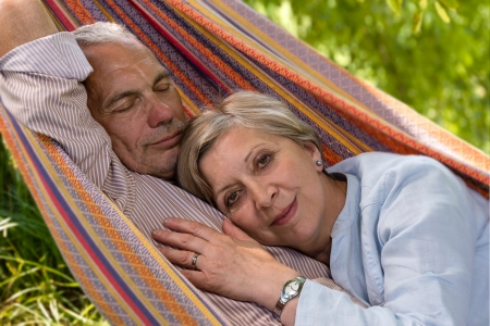 Closeup of senior Caucasian couple in hammock photo