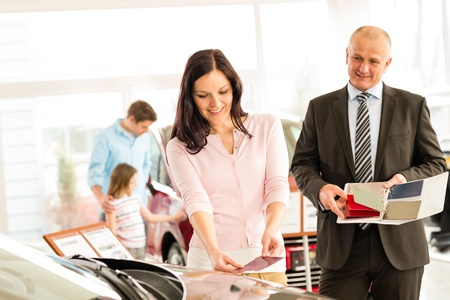 young wife: Young wife choosing the color of family car