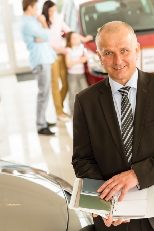 Portrait of car salesman with color swatches photo