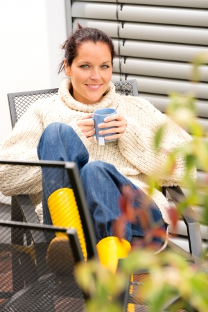 Happy woman autumn relaxing cup hot tea sitting backyard sweater photo