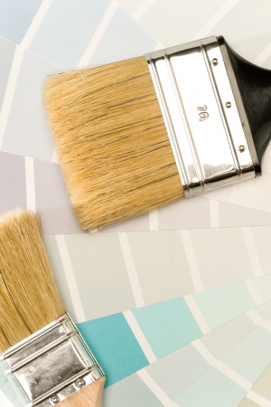 painting and decorating: Shade card and paint brushes Stock Photo