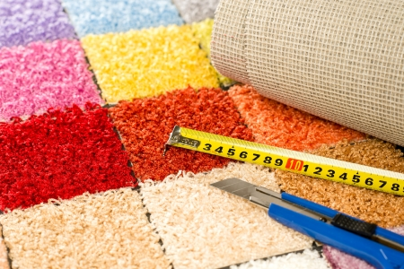 boxcutter: Carpeting colorful swatches, boxcutter and tape measure
