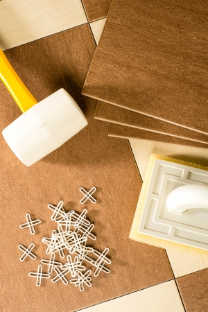 tile flooring: Flooring tools tiles, tile spacers Stock Photo