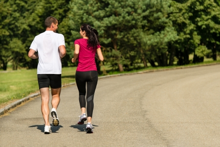 Rear view of jogging Caucasian couple outdoors Stock Photo - 22212875