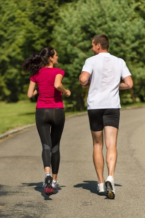Rear view of couple friends jogging together outdoors Stock Photo - 22212901