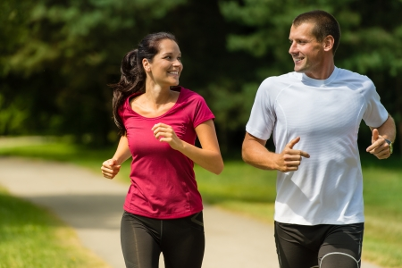 and the horizontal man: Portrait of cheerful Caucasian couple running outdoors