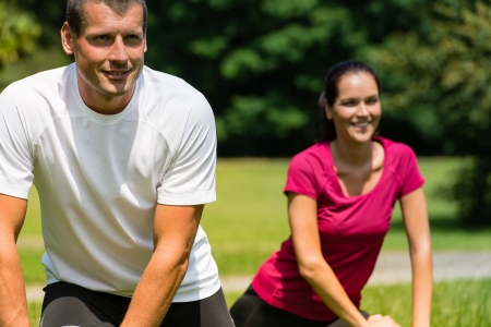 Close up portrait of smiling couple stretching outdoors Stock Photo - 22213217