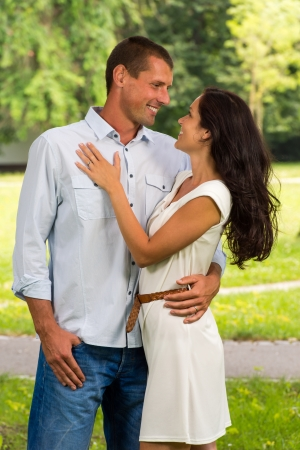 Smiling boyfriend and girlfriend embracing outdoors Stock Photo - 22213275