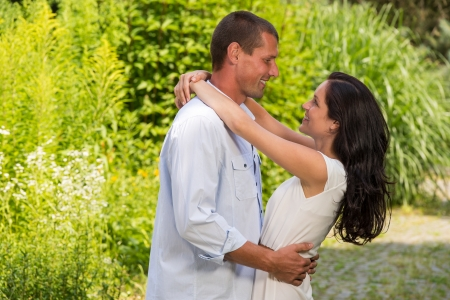 Playful Caucasian couple in love embracing outdoors Stock Photo - 22213290