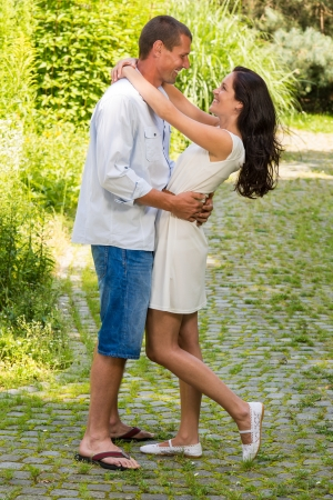Joyful couple standing and hugging in park Stock Photo - 22213296