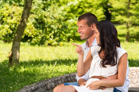 Loving couple sitting in park and laughing Stock Photo - 22213292