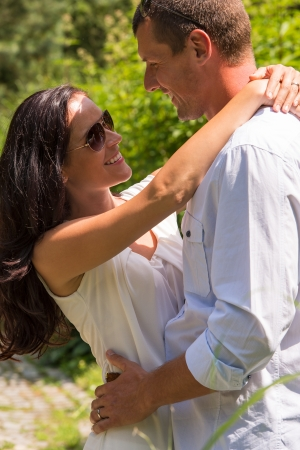 Close up portrait of hugging couple outdoors sunny park Stock Photo - 22213434
