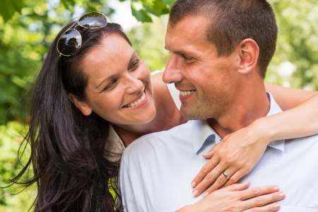 Portrait of happy affectionate couple hugging in park Stock Photo - 22213443