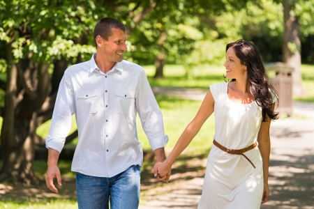 Happy couple walking and laughing in a park Stock Photo - 22213543