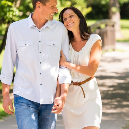 Portrait of young happy couple embracing in park Stock Photo - 22213580