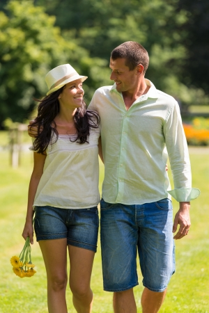 Couple in love walking outdoors and looking at each other photo