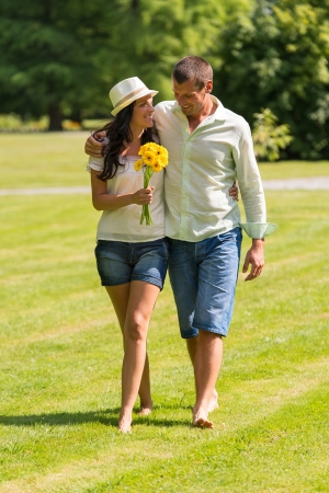 Happy young couple walking in park barefoot Stock Photo - 22213618