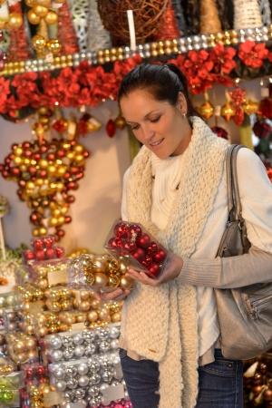 Young woman shopping christmas balls in shop Stock Photo - 22227014