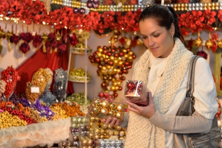 Woman at christmas decoration shop holding boxes of Xmas balls Stock Photo - 22227015