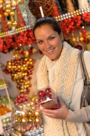 Smiling woman buying Christmas balls at shop Stock Photo - 22227016