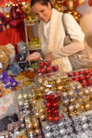 Pile of Christmas balls in plastic boxes woman shopping Stock Photo - 22227017