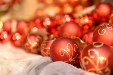 Pile of red Christmas balls with gold ornament photo