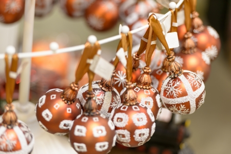 Hanging glittering bronze Christmas decorations bulbs Stock Photo - 22175226