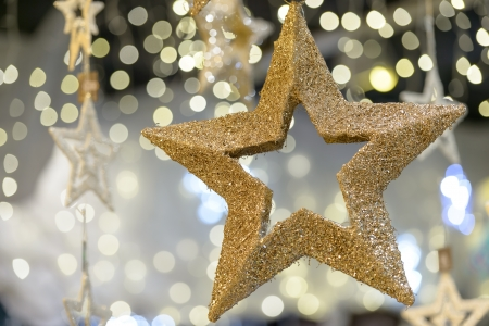 Hanging golden star Christmas decoration on blurred background Stock Photo - 22175229