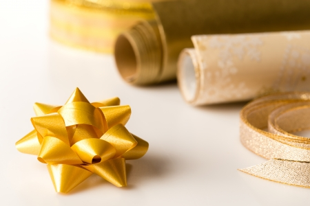 Golden wrapping paper and bow for christmas present decoration Stock Photo - 22396461