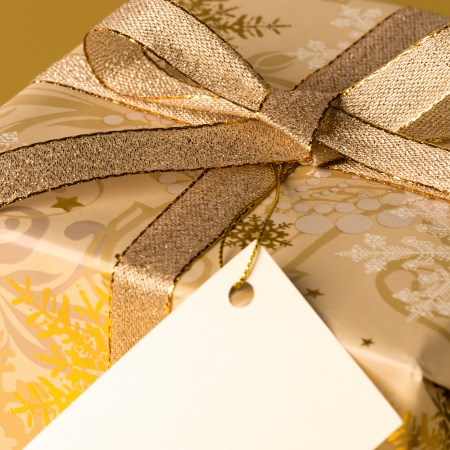 Gold Christmas gift with blank label wishing card Stock Photo - 22396464