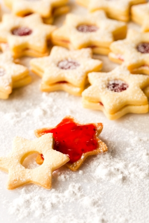 Gingerbread christmas cookie star with jam and powdered sugar Stock Photo - 22396471