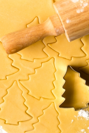 Baking christmas cookies raw dough with rolling pin and cutter Stock Photo - 22396513