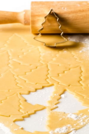 Christmas cookie dough baking sweets with rolling pin and cutter Stock Photo - 22396519