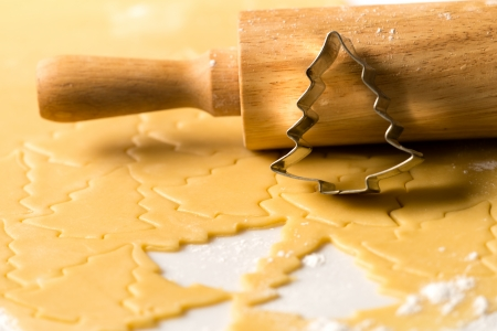 Baking christmas cookies raw dough with rolling pin and cutter photo