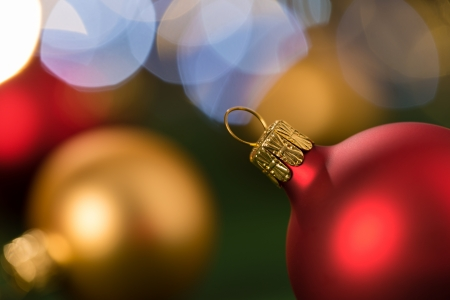 Christmas red and gold balls close-up shining lights background photo